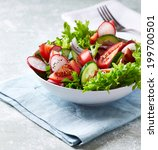 bowl of summer salad  | Shutterstock . vector #199700501