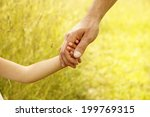 a parent holds the hand of a... | Shutterstock . vector #199769315