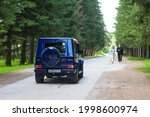 Small photo of Mercedes-Benz G-Class (G 500) on the road Novosibirsk, Russia - 06. 19. 2021: Mercedes-Benz G 55 on the road in the forest. The G-Class is the one of the most luxury SUV vehicles in the world.