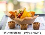 nachos salsa in a street cafe...   Shutterstock . vector #1998670241