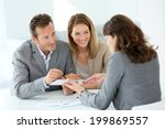 couple signing loan grant on...   Shutterstock . vector #199869557