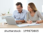 couple at home working on... | Shutterstock . vector #199870805