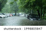 Flooded Cars On The Street Of...