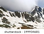 Mountain Summits Under Thick...