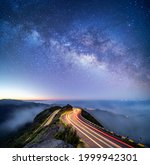 Astrophotography shot of hairpin turn with galactic core milky way rising on Madeira Island, Portugal