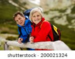 senior tourist couple hiking at ... | Shutterstock . vector #200021324
