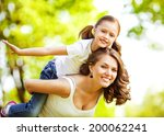 mother and daughter in park.... | Shutterstock . vector #200062241