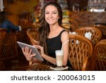 happy young woman drinking... | Shutterstock . vector #200063015