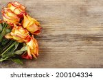 Orange Roses On Wooden...