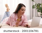 Woman With Credit Card Using...