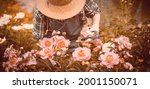 A Gardener Girl In A Straw Hat...