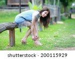 beautiful young woman in garden.... | Shutterstock . vector #200115929