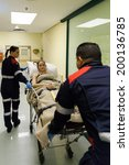 Paramedics Taking Patient To...