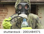 A Man In A Gas Mask Drink Water ...