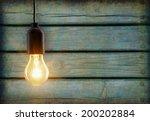 light bulb lamp on wooden... | Shutterstock . vector #200202884