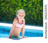 smiling cute little girl swims... | Shutterstock . vector #200225351