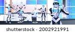 robots with scientist in... | Shutterstock .eps vector #2002921991