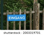 Sign On A Wooden Fence In...