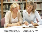 college tutor with student | Shutterstock . vector #200337779