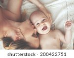portrait of a mother with her 3 ... | Shutterstock . vector #200422751