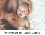 portrait of a mother with her 3 ... | Shutterstock . vector #200422841