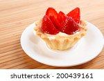 sweet cake with fruits on white background - stock photo