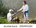elderly couple fishing on a... | Shutterstock . vector #200494184