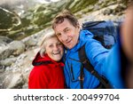 Senior Tourist Couple Hiking...