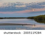 Full Moon Sets Over Pond At...