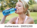 blond woman drink water after... | Shutterstock . vector #20051200