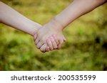 children holding hands   Shutterstock . vector #200535599