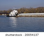A Towboat Pushing A Barge On...