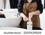asian woman hair stylist pump... | Shutterstock . vector #2005439834