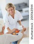 homecarer giving tea to elderly ... | Shutterstock . vector #200563544