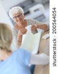 homecarer reading book to... | Shutterstock . vector #200564054