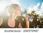 beautiful young woman drinking... | Shutterstock . vector #200570987