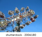 A ride at the fairground with blue sky as backdrop. - stock photo