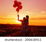 baby and mother with balloons... | Shutterstock . vector #200618411