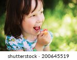 eating berry. | Shutterstock . vector #200645519
