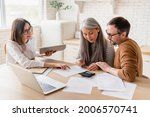 Small photo of Insurance agent consulting mature family couple, discussing health insurance, signing contract deal of loan pension mortgage at home, calculating funds, investments, savings
