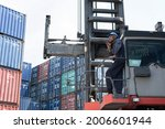 black container worker hold... | Shutterstock . vector #2006601944