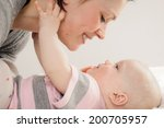 mother with her baby on white... | Shutterstock . vector #200705957