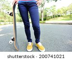 woman skateboarder hold... | Shutterstock . vector #200741021