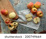 Peel And Sliced Apples On A...