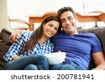 couple sitting on sofa watching ... | Shutterstock . vector #200781941