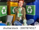 Small photo of female sorting garbage. Redhead eco-friendly female separate waste and throwing trash into recycling bins. Ecology. Waste and garbage, environmental segregation. focus on plastic bottle