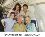 family sitting on airplane | Shutterstock . vector #200809124