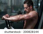 young bodybuilder doing heavy... | Shutterstock . vector #200828144