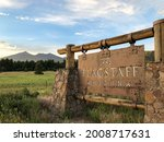 Rustic sign at the town limits of Flagstaff, Arizona