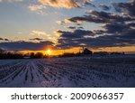 Winter Sunset Over Farm In...